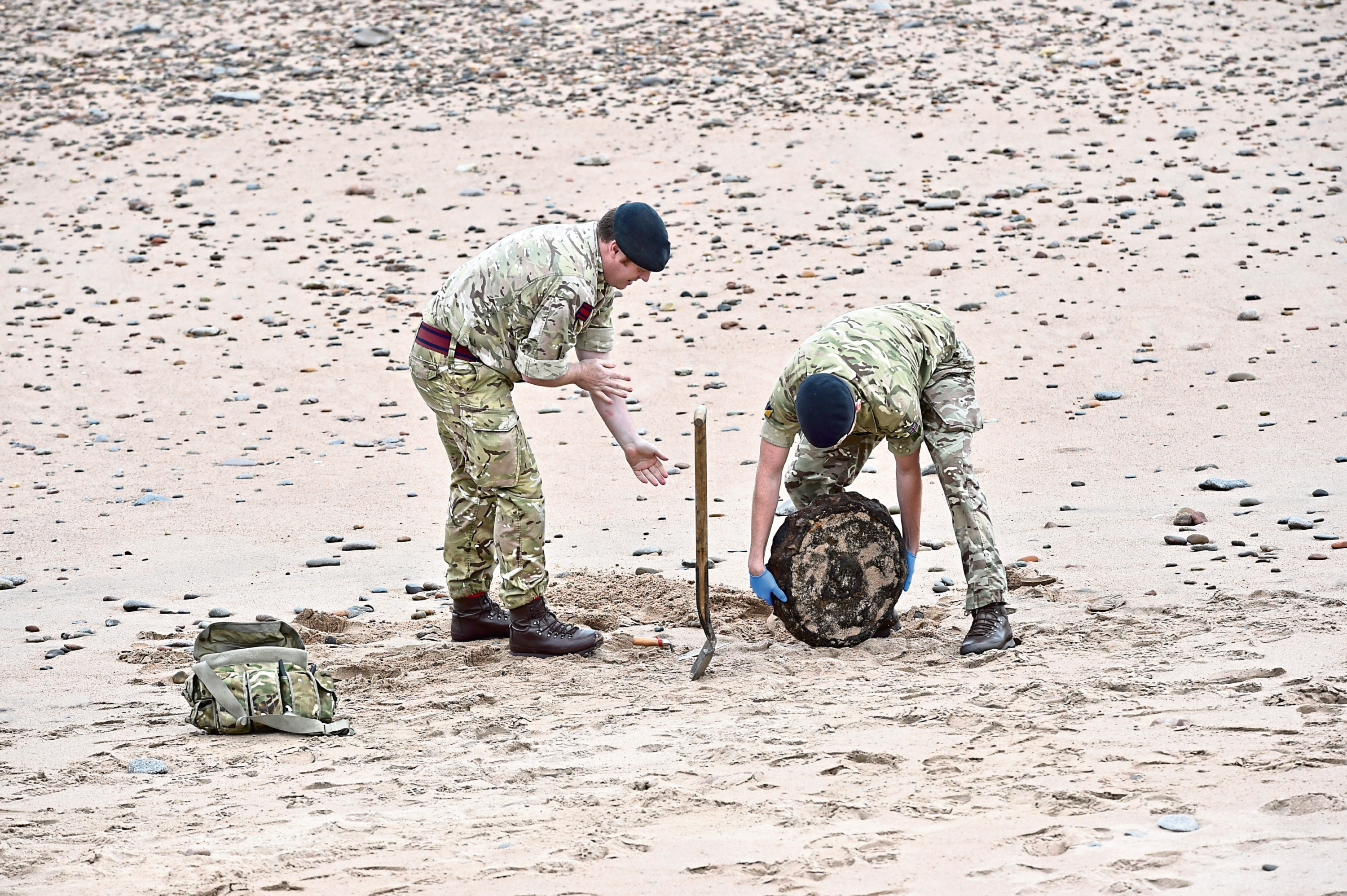A bomb disposal crew at work on Aberdeen beach