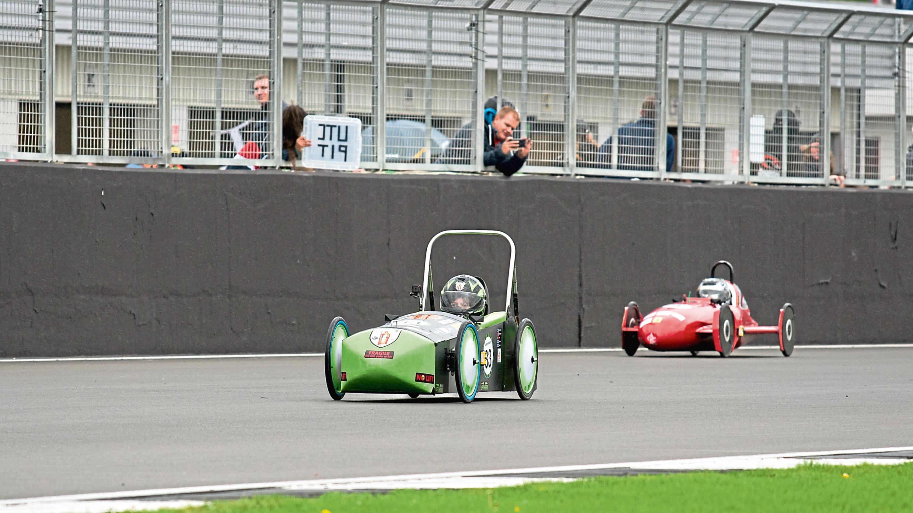 The electric cars race at the international final at Silverstone