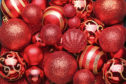 Red christmas baubles background istock