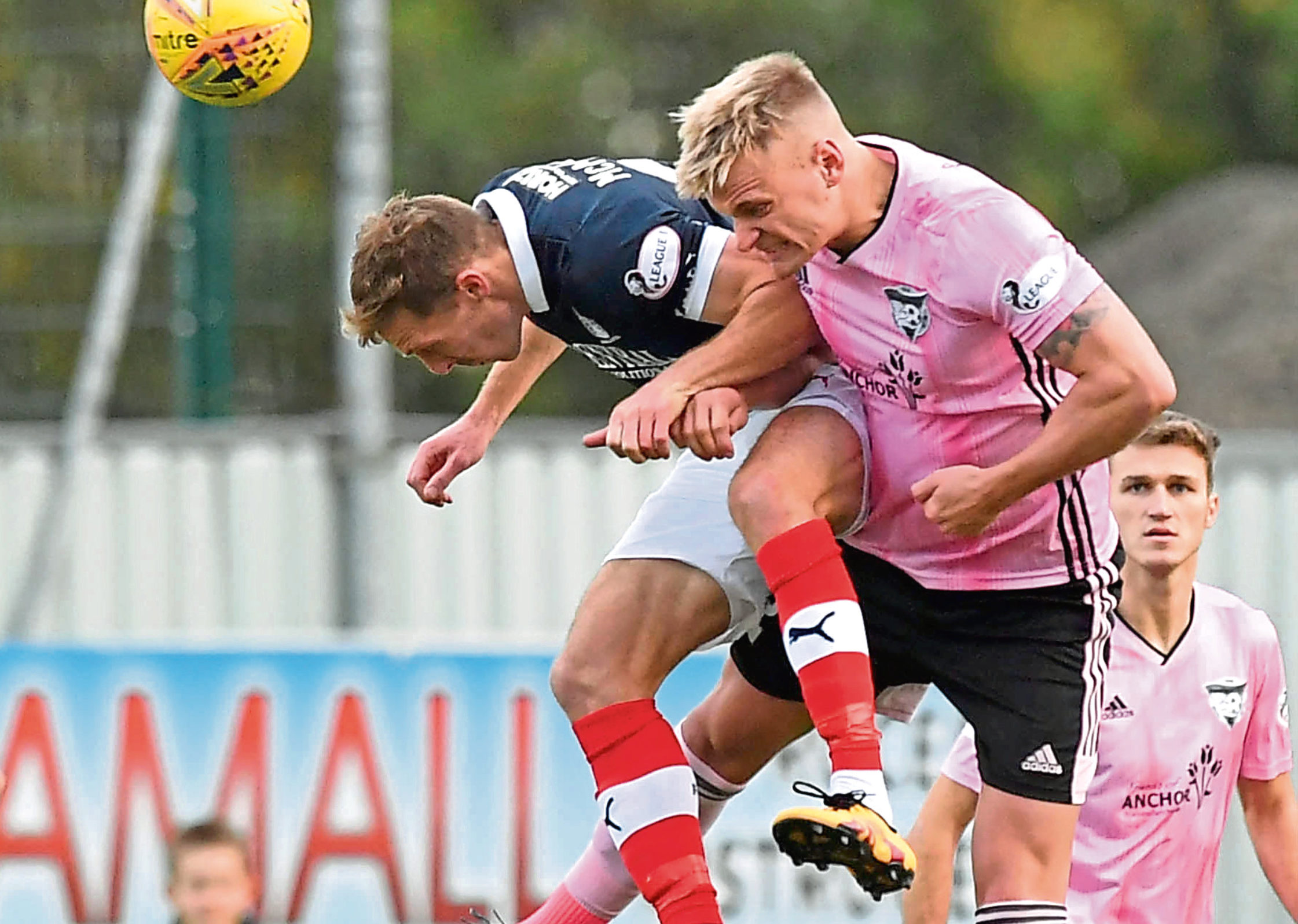 Peterhead's Jason Brown clears from Declan McManus, of Falkirk.