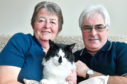 Margaret and James Rae  with their cat Holly