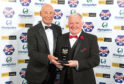 Joe Harper is presented with his award by Drew Jarvie as he is inducted into the Scottish Football Hall of Fame