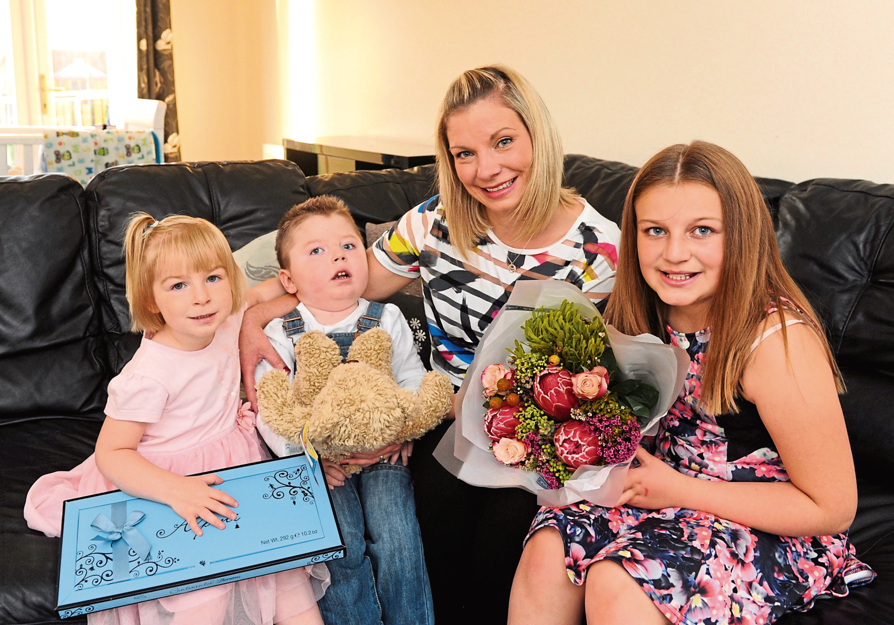 Jack Walker with mum Shelley and sisters Eve-Rose and Ruby pictured in 2014 after winning the EE's Happy Tots competition