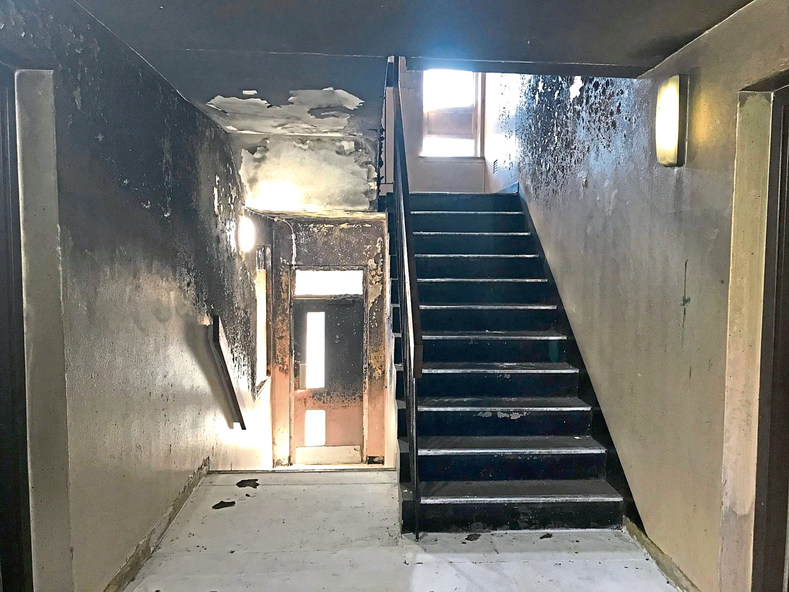 The fire damaged hallway in the building