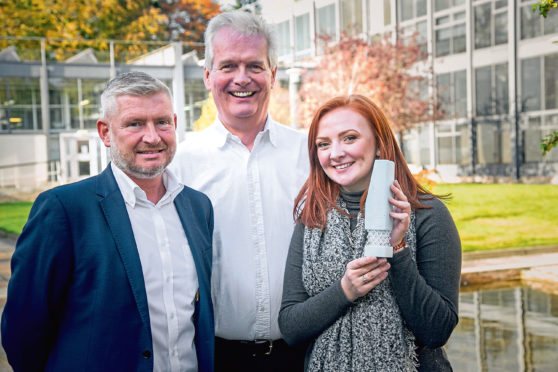 Pete Baker from TAQA and Ian Phillips from SPE with winner Rachel Mackay
