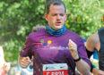 Aberdeen Donside MSP Mark McDonald competing in the Chicago Marathon to raise money for SensationALL