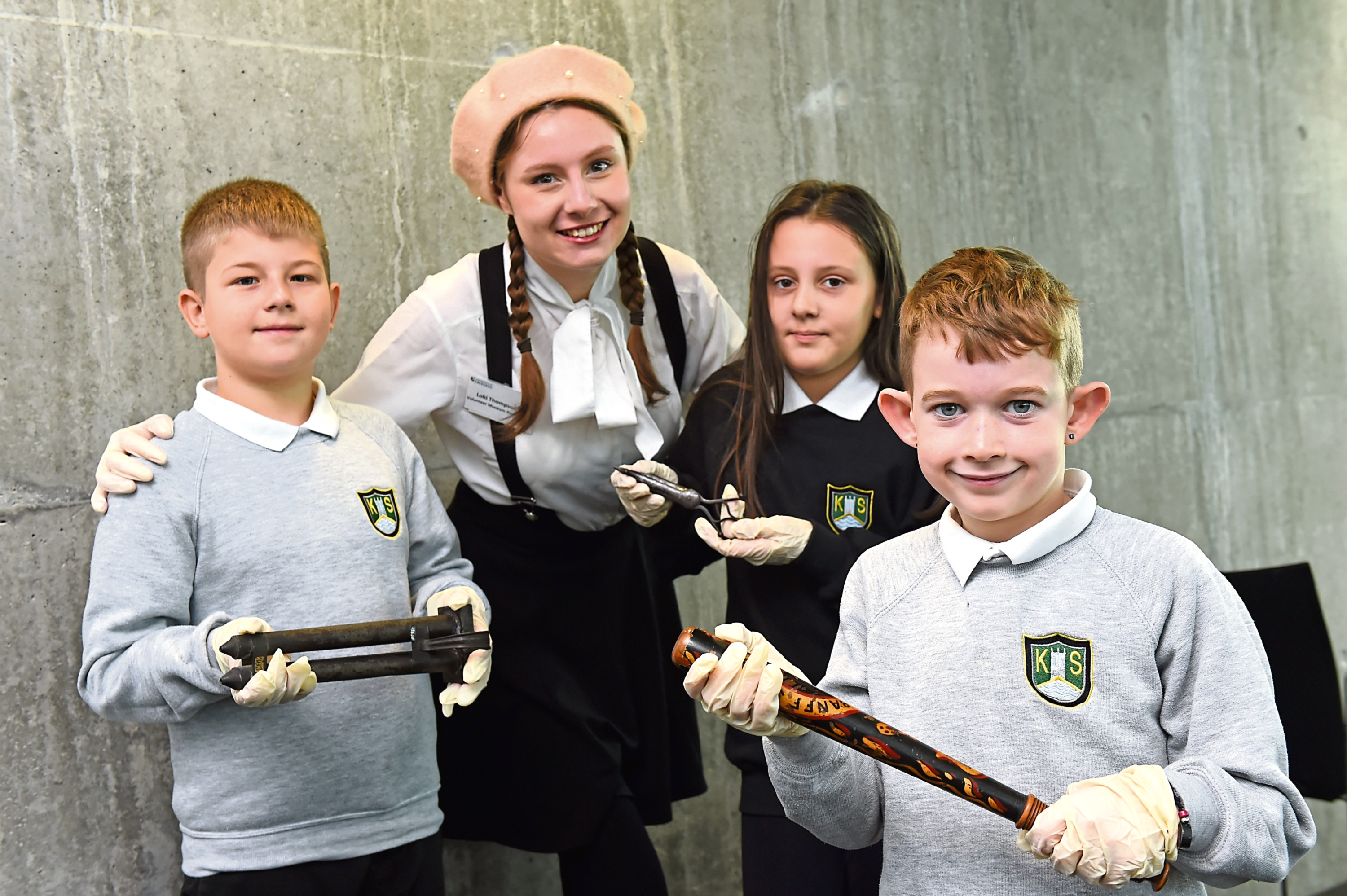 Kirkhill Primary pupils Filip, Julia and Lyle with Loki Thompson of King's Museum