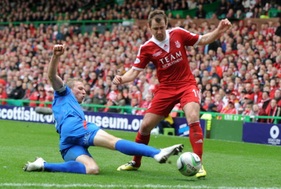 Inverness' Richie Foran and Aberdeen's Niall McGinn during the 2014 League Cup final.