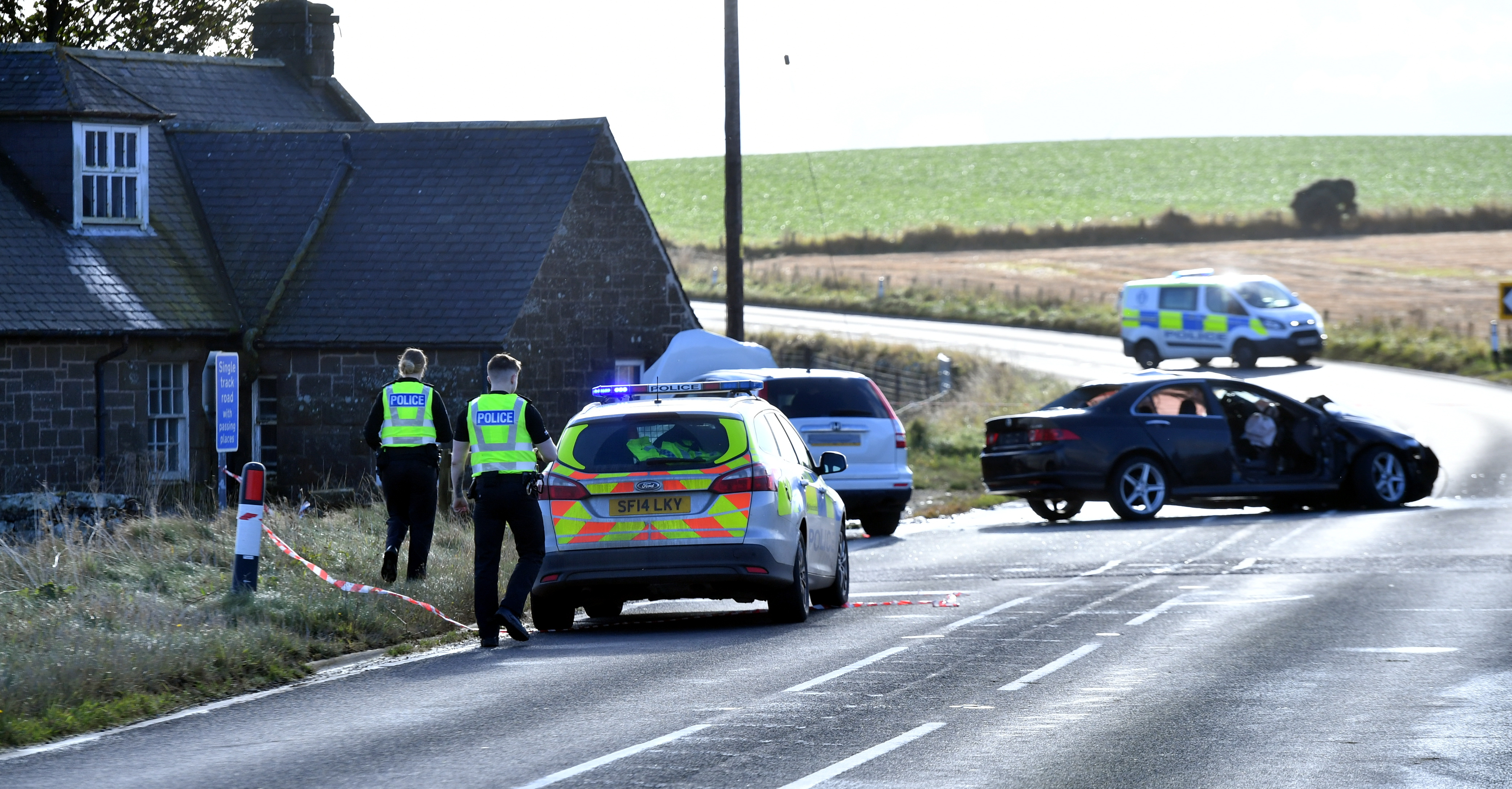Police at the scene of the collision on the A92