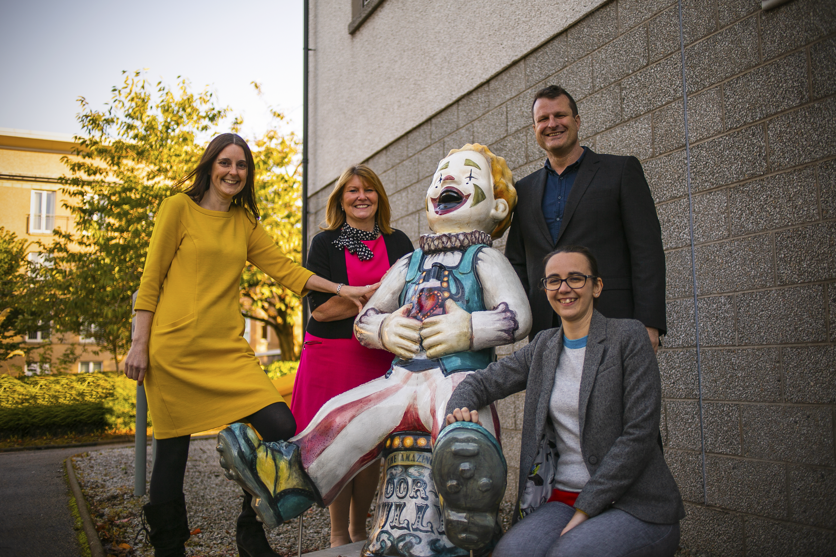Rachael Smith and Sheila Reid of CAMHS and Tony Dinozzi and Katrina McKay of Wood with the sculpture