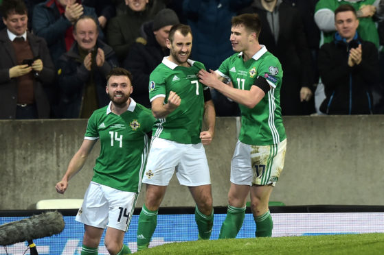 McGinn is away with Northern Ireland.