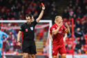 Aberdeen's Curtis Main, right, is sent off by referee Don Robertson during the Ladbrokes Premiership match between Aberdeen and Hibs.