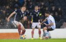 The rain continues to cause havoc as Scotland's Scott McTominay, left, is pictured in action with San Marino's Alessandro Golinucci during the UEFA European qualifier between Scotland and San Marino.