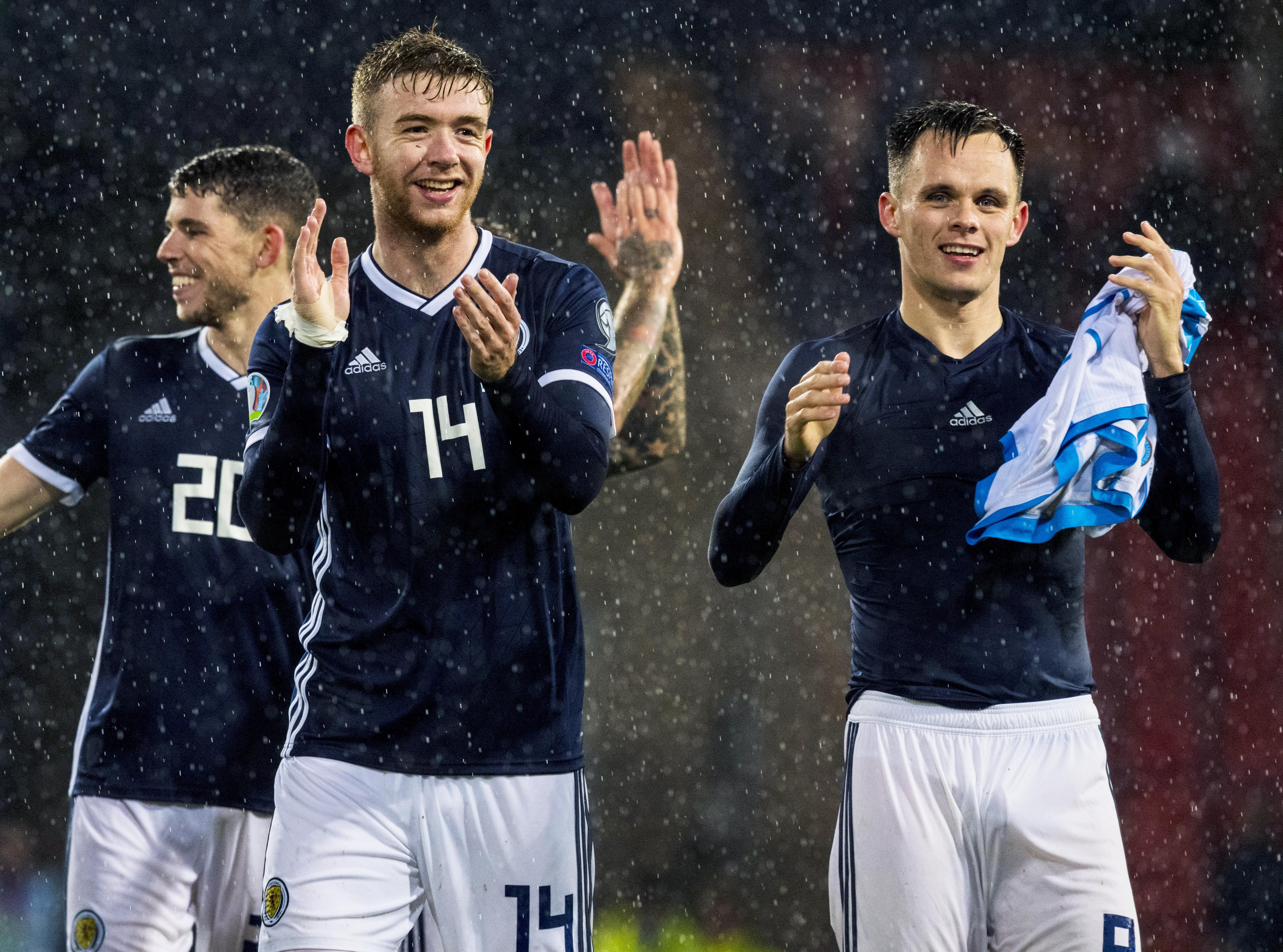 Lawrence Shankland, right, in the dark blue of Scotland.