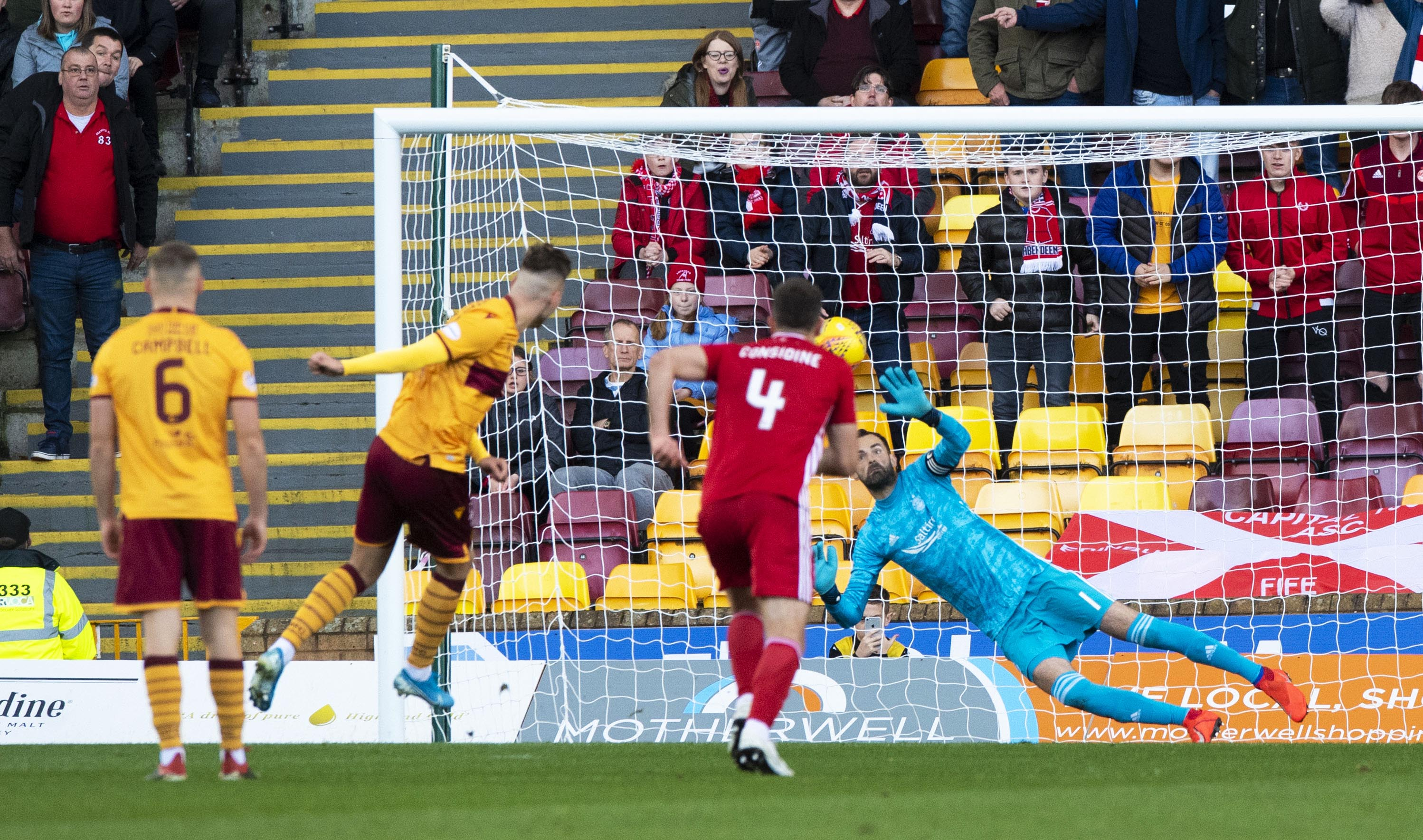 Aberdeen's Joe Lewis is pictured saving Motherwell's James Scotts's penalty at Fir Park.