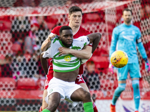 Back in action for the Dons, Scott McKenna grapples with Celtic's Odsonne Edouard during the Ladbrokes Premiership match between Aberdeen and Celtic.