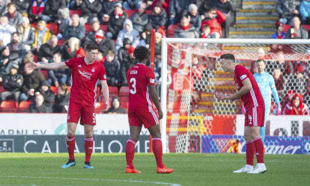 Aberdeen's Scott McKenna, Greig Leigh and Andy Considine (L-R) exchange words during the Ladbrokes Premiership match between Aberdeen and Celtic.
