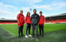 Pictured is Steven Sweeney, 3rd from left, Community Operations Manager, Aberdeen Community Trust, with volunteers, from left, Steven Harvey, Jenna McDonald and Paul Davidson at Pittodrie.