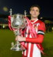 Formartine United captain Stuart Anderson with the Evening Express Aberdeenshire Cup after their 2017 success