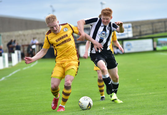 Fraserburgh's Owen Cairns, right, holds off Aaron Hamilton of Forres Mechanics