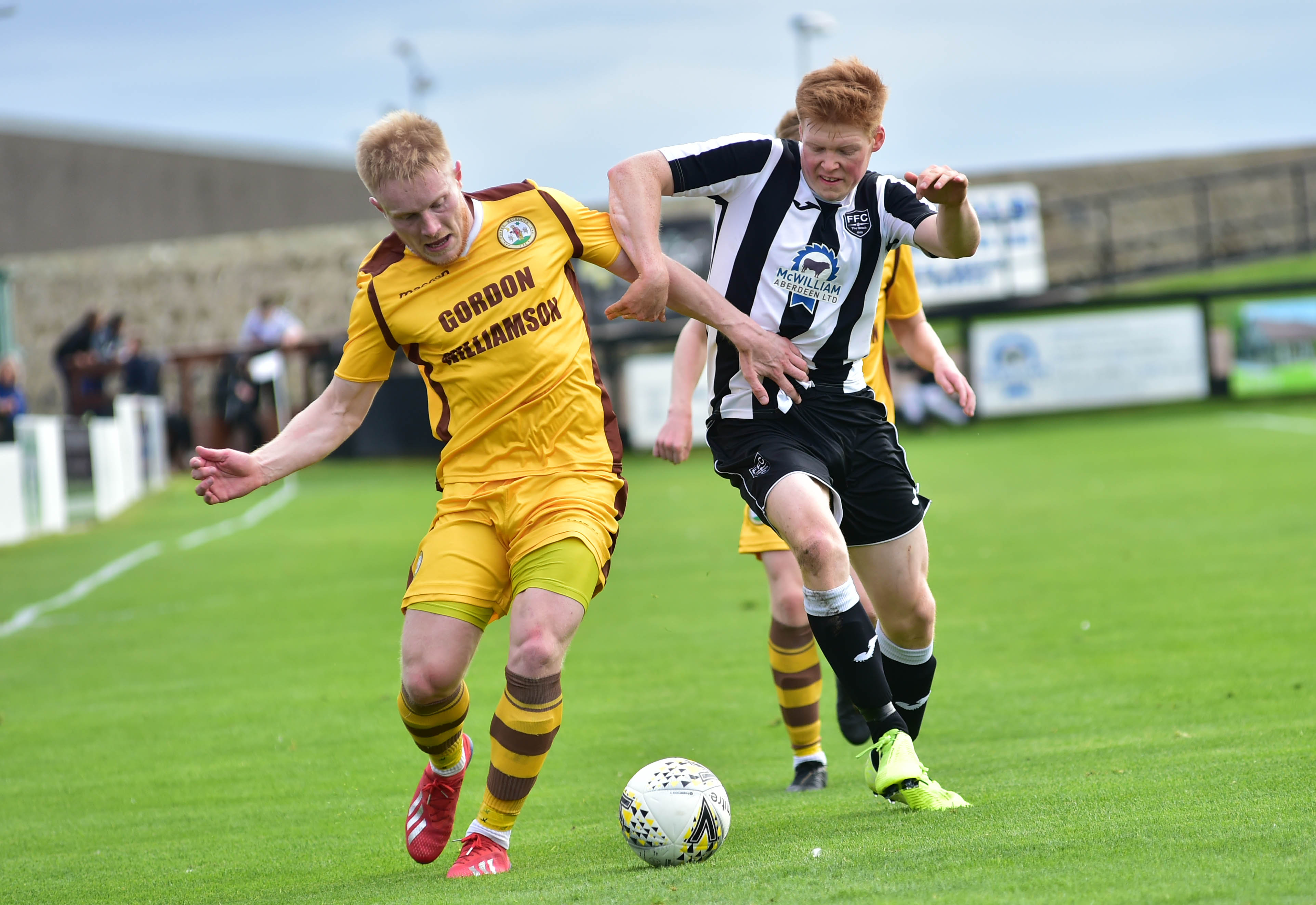 Fraserburgh's Owen Cairns, right, holds off Aaron Hamilton of Forres Mechanics.