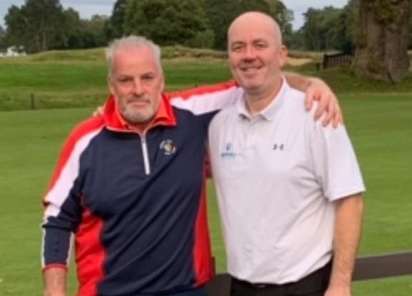 Jon Roberts, left, with Cruden Bay team-mate Iain Buchan at Woodhall Spa after winning the holiday to Dubai.