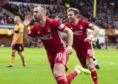 Niall McGinn celebrates scoring  Aberdeen's second goal