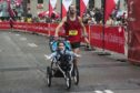 Calum Neff and his daughter Alessandra break a world record for fastest marathon run while pushing a stroller during the Scotiabank Toronto Waterfront Marathon