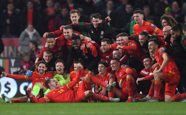 Wales player Aaron Ramsey, front, joins in the celebrations with Gareth Bale and his team-mates after the UEFA Euro 2020 qualifier between Wales and Hungary at Cardiff City Stadium. Aberdeen's Ryan Hedges can be seen in black jacket to the right of the image.