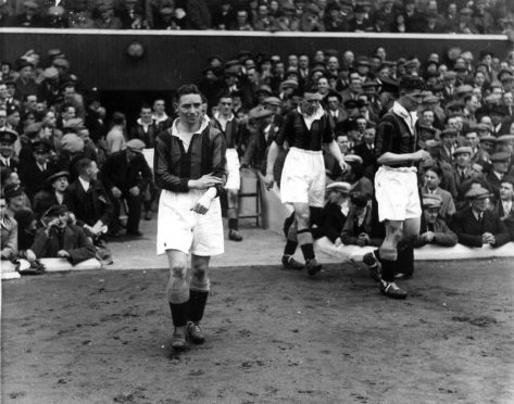 1937 Scottish Cup Final. Hampden Park. Celtic 2  Aberdeen 1. Matt Armstrong rolls up his sleeves as he steps onto the Hampden turf before a massive 146,433 crowd - an all-time British club record.
