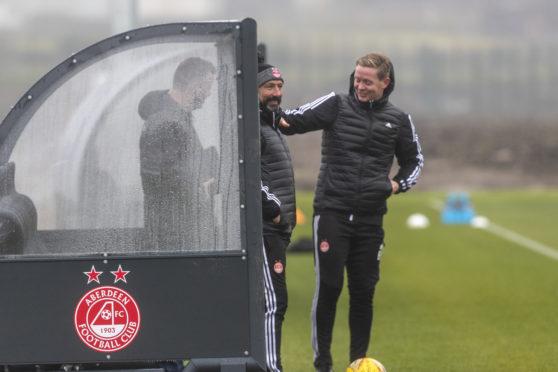 Barry Robson laughs with Derek McInnes.
