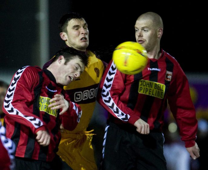 John Sutton is crowded out buy Inverurie Locos' Geir Pirie and Steven Park (left).