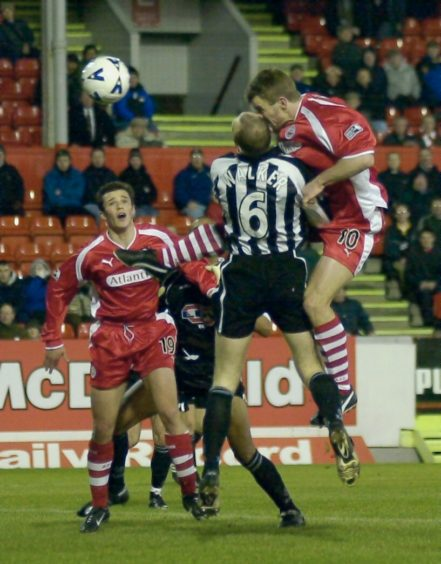 Stavrum heads in the first goal for Aberdeen against St Mirren.