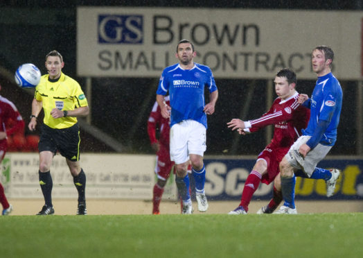Ryan Jack, second right, unleashes a shot from halfway to beat stranded St Johnstone keeper Peter Enckelman.
