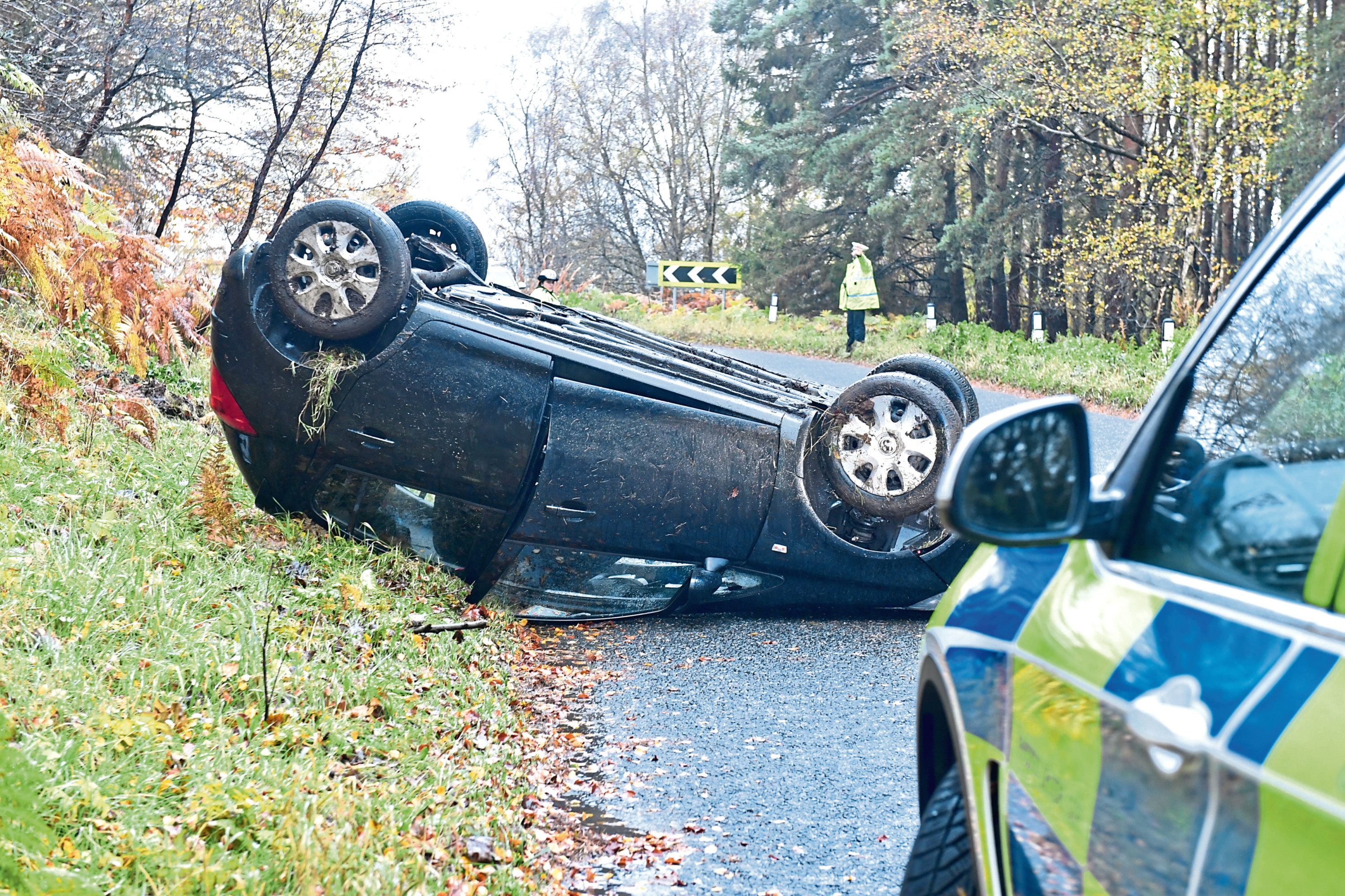 The car on its roof on the B993 between Kemnay and Inverurie
