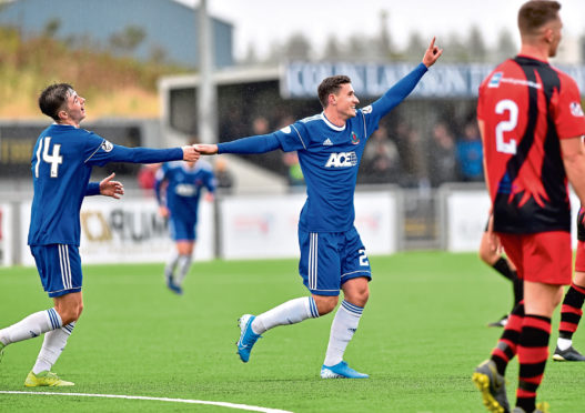 Fraser Aird in action for Cove.