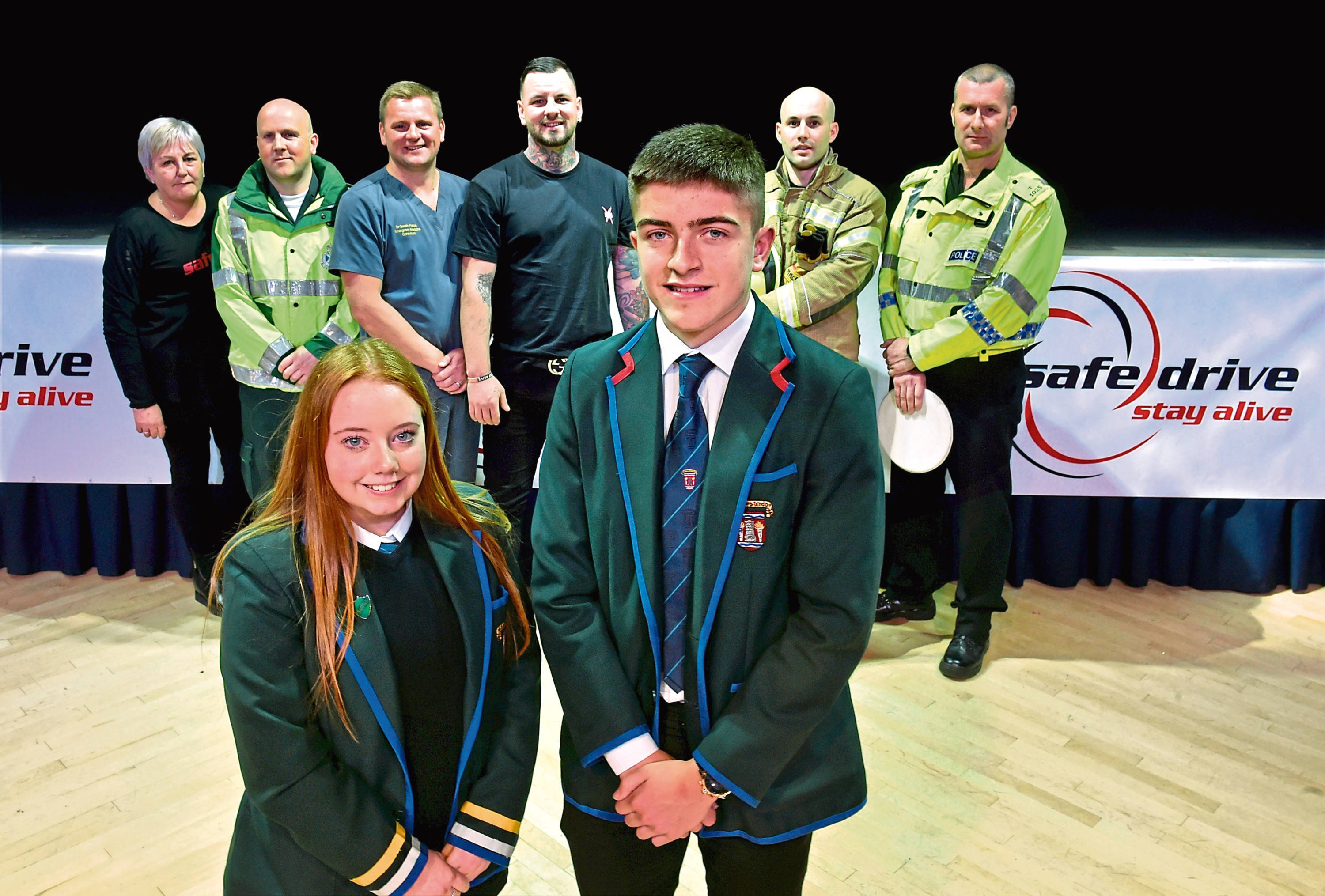 Hazlehead fifth-year pupils Andy Paterson and Maisie Murray at the Safe Drive Stay Alive event with – back, from left, Dorothy Anne Scott (parent), Scott Burnett, Gareth Patton, Chris Tucker (car crash survivor), Scott MacRory and Andy Ramsay. Picture by Colin Rennie