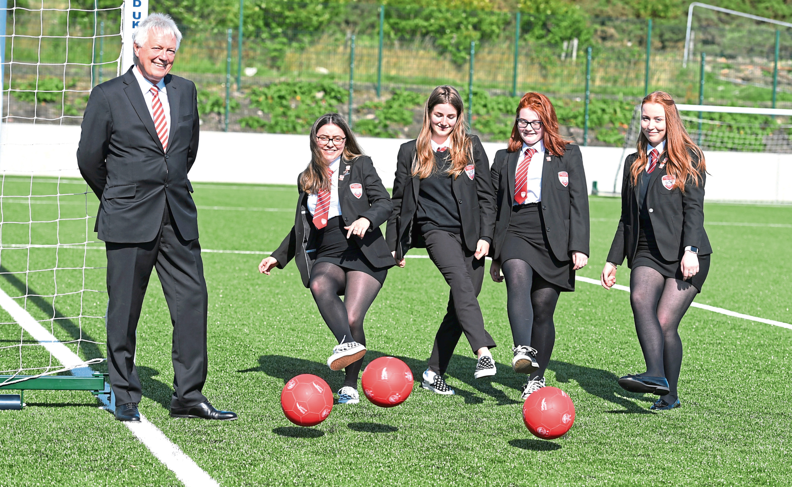 Duncan Skinner, chairman of Aberdeen Football Club Community Trust, with pupils from left, Rachel Milne, Laura Forsyth, Erin Christie and Abbey McCabe