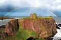 Men were seen climbing dangerous cliffs near Dunnottar Castle