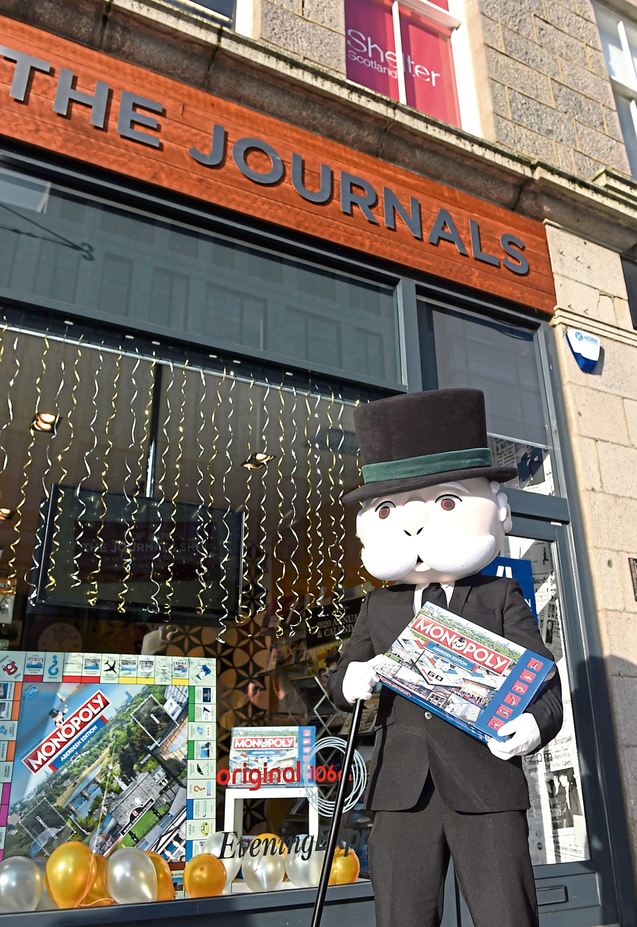 mr monopoly, the game's mascot, paid a visit to the aberdeen Journals shop on Schoolhill