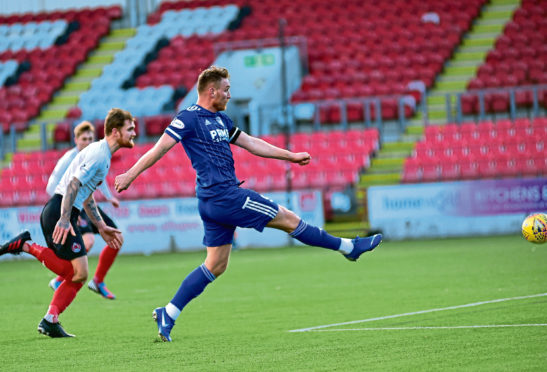 Rory McAllister scores his second.