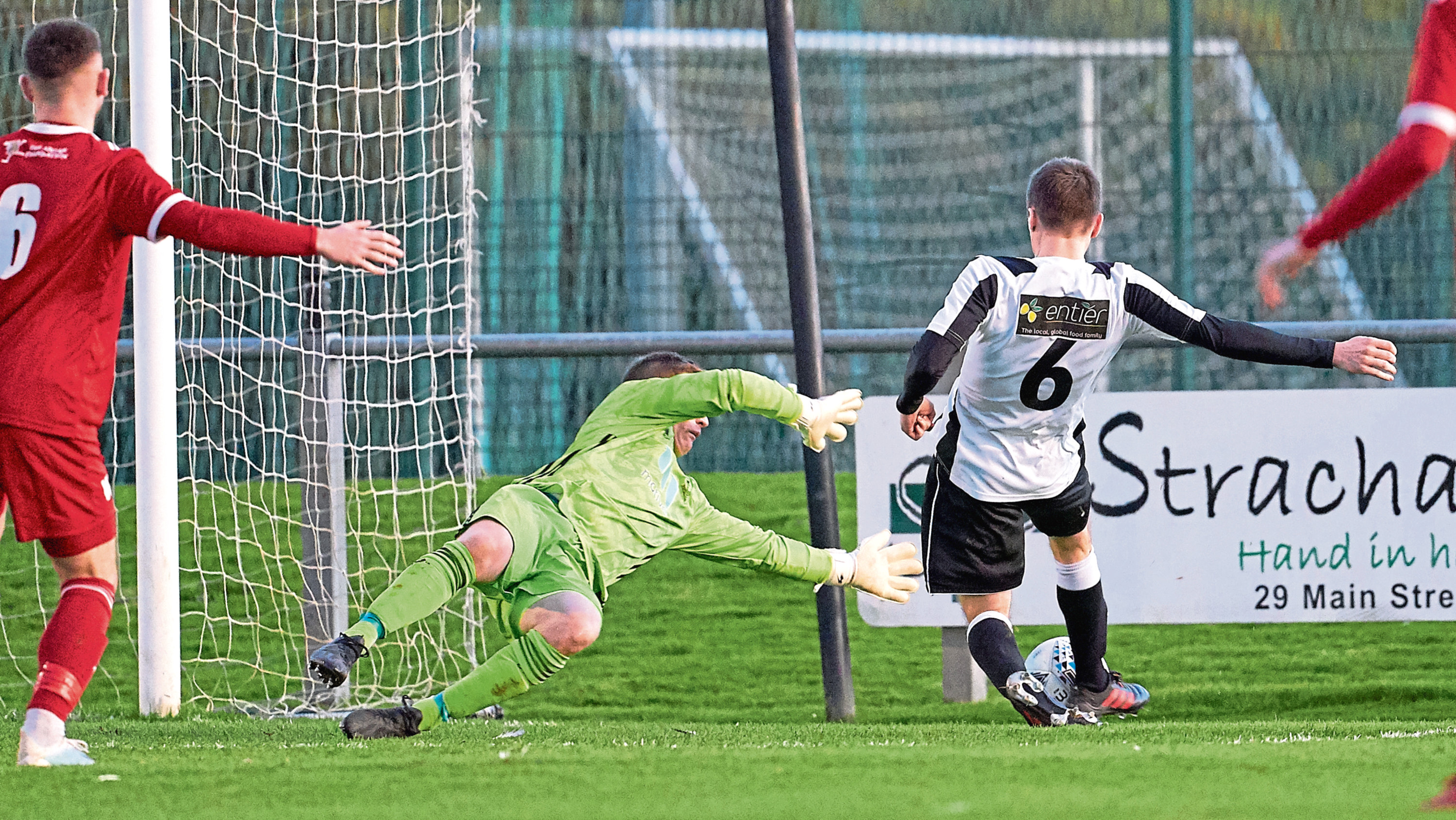 A Paul Young strike is saved by Grant Pennet of Deveronvale.