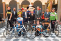 Representatives from Aberdeen and Aberdeenshire councils and the Tour of Britain, along with cyclists at Aberdeen Art Gallery. Picture by Kenny Elrick