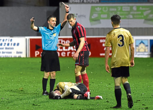 Andy Hunter being shown a red card. Pictures by Kenny Elrick