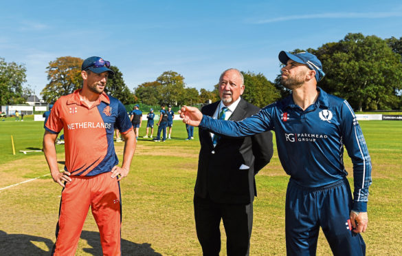 Kyle Coetzer of Scotland tosses the coin with Pieter Seelaar of  the Netherlands prior to the T20 International Tri Series match between Scotland and the Netherlands.