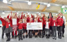 Jumping for joy at Airyhall Primary School as pupils and staff receive cheque