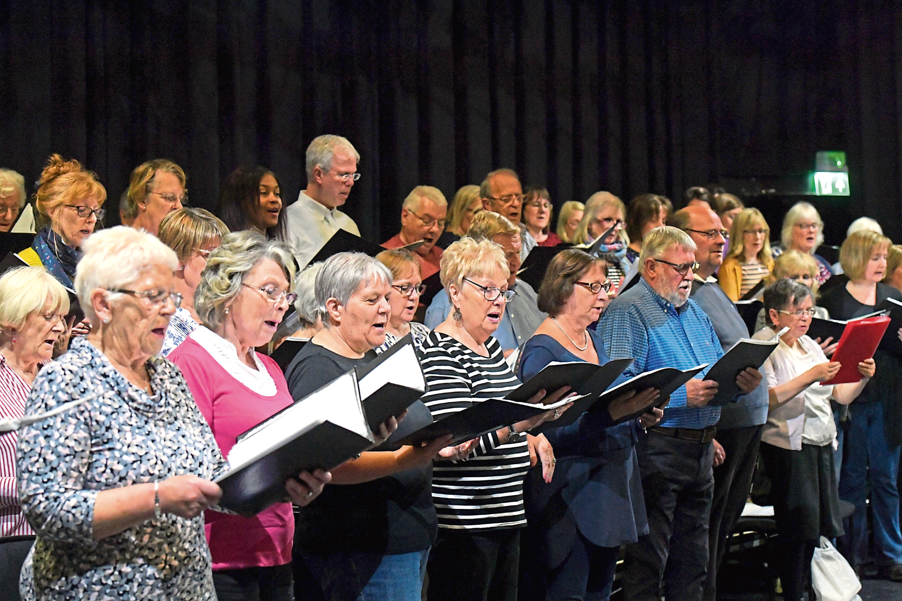 The Music Hall was reopened with a performance by Travis' Fran Healy with the APA community choir, pictured