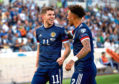 Scotland's Ryan Christie, left, celebrates scoring his first Dark Blues goal with Liam Palmer.