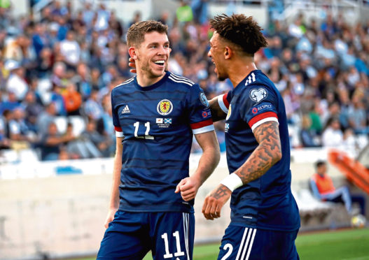 Scotland's Ryan Christie, left, celebrates scoring his first Dark Blues goal with Liam Palmer.