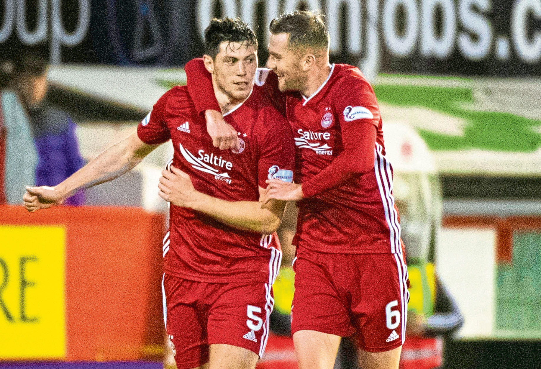 McKenna, now, with Aberdeen teammate Michael Devlin.